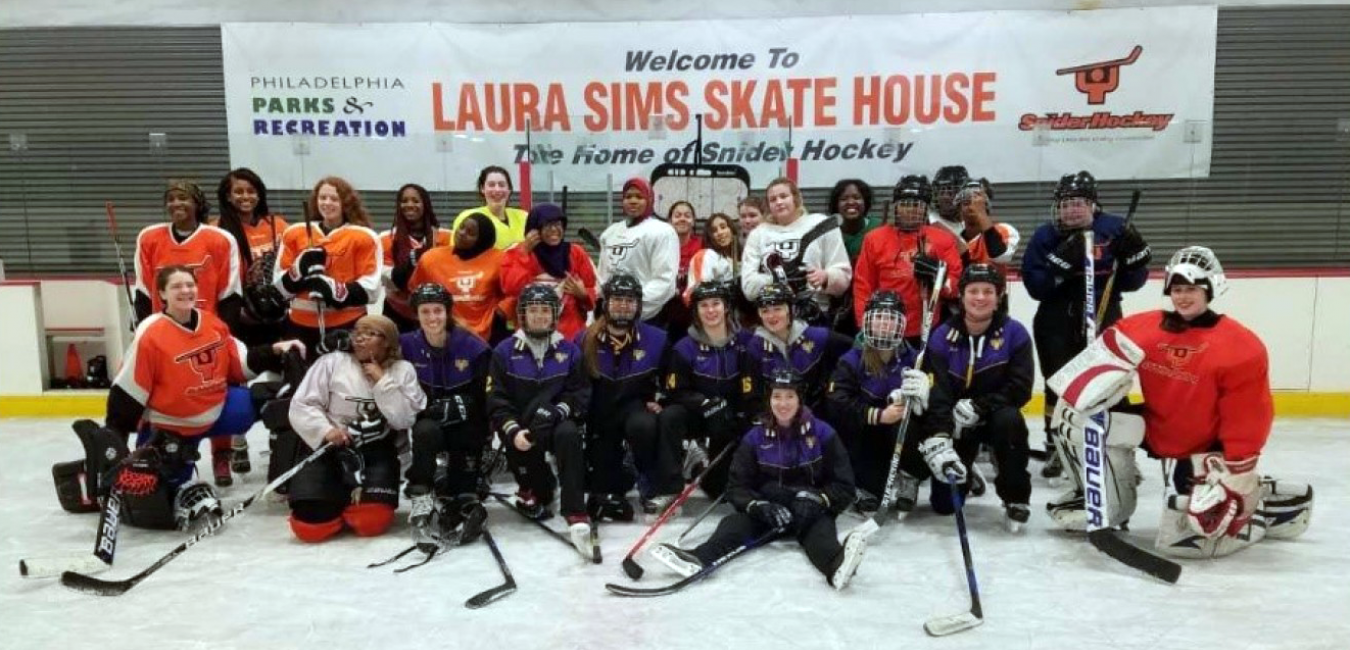 a group of kids in hockey gear pose on an ice rink