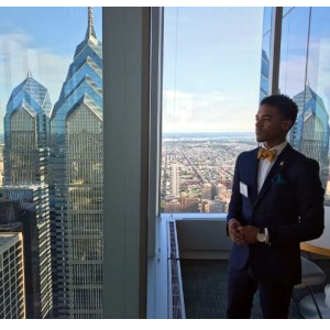 Kaseir poses in front of the Philadelphia skyline